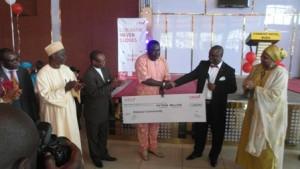 Isong handing over cheque to representative of Bakassi people