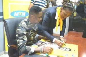 MTN Cameroon  CEO endorsing Eto'o  as the company's brand Ambassador