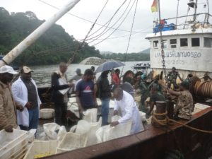 Dr Ndi (in white overalls) inspecting the fish seized from   Chinese trawler