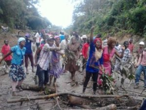 irate wone villagers block road