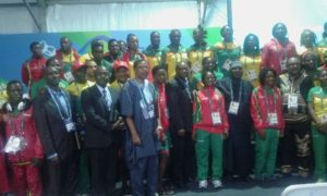 Kalbaba Malboum poses with team Cameroon