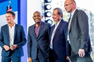 Tony Elumelu(2nd  from L) and delegates at the MEDEF Summer University Forum in Paris