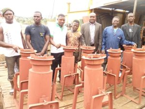 Trainees display gasifier stoves that would produce energy for households
