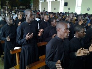 Seminarians praying for the repose of the souls of the Eseka train victims  during National Day of Mourning