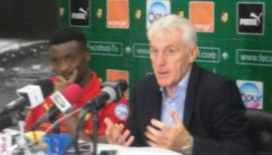 Hugo Broos and Moukanjo at press conference