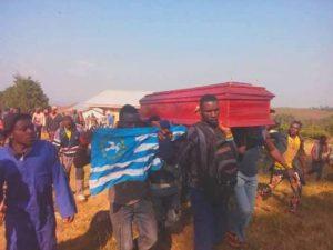 Ambazonian Flag Accopmpanying Victim of Strike To The Graveyard